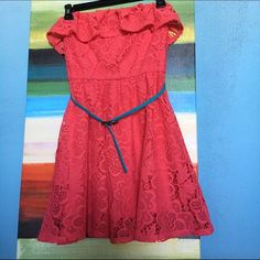 Cute Coral Dress Beautiful lace, Ruffles at the top, and best of all it has pockets! The belt is included of course. American Rag Dresses Strapless
