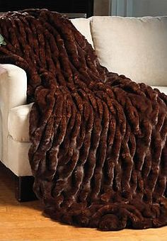 With remarkable realism, Mahogany Mink captures the subtle, gradient color of nature. Velvet-lined, Mahogany Mink faux fur throws are machine wash/line dry.