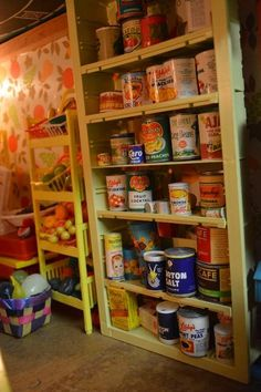 Found on EstateSales.NET: Shelves filled with miniature vintage canned goods!