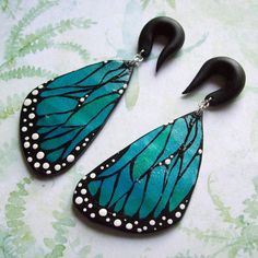 Dangling butterfly wing 00 gadge plugs...