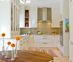 Transitional U-shaped Cream kitchen, white cabinets, Venegas and Company, Barbara Baratz,