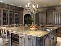 NOT my kitchen. Antique Kitchen Island Ideas With Exclusive Old Antique Gray Marble Carved Cabinets Cupboards Kitchen Dining Design Luxury Chandelier Kitchen Remodel, Luxury Kitchens, Kitchen Design, Classic Kitchens, Traditional Kitchen, Kitchen Cabinet Styles, Old World Kitchens, Dream Kitchen, Kitchen Style