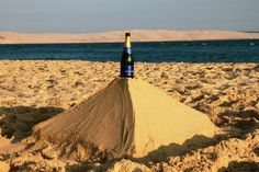 Our pyramid in Cap Ferret, France about when finishing our champagne beach picnic in August 2012.