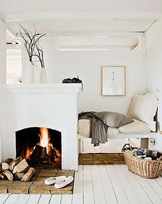 Studio apartment ideas... Dividing the room / creating an alcove for the bed with a portable fireplace.