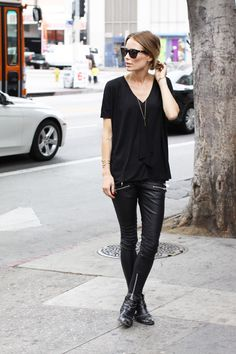 Leather pants, black tee, boots, and classic Wayfarers.