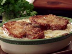 Country Pork Chop and Potatoes with Black Pepper White Gravy from FoodNetwork.com