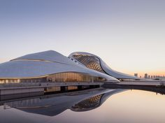 Completed in 2015 in Harbin, China. Images by Adam Mørk, Hufton+Crow . MAD Architects unveils the completed Harbin Opera House, located in the Northern Chinese city of Harbin. In MAD won the international open. Asian Architecture, Architecture Wallpaper, Contemporary Architecture, Architecture Design, Organic Architecture, Amazing Architecture, Biomimicry Architecture, Creative Architecture, Architecture Student