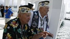 Pearl Harbor survivors George Richard (L) and Charlie Boswell tour the Arizona Memorial