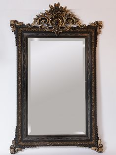 #NapoleonIII mirror in blackened #wood and #gilt stucco. Nice work of the #19th century. For sale on Proantic by La Malle d'Elisa.