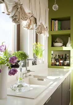 green walls, grey cabinets and white tabletop kitchen