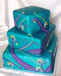 This is one of my FAVORITES. Peacock-themed cake by Sweetest Perfections. Beautiful and very cool!