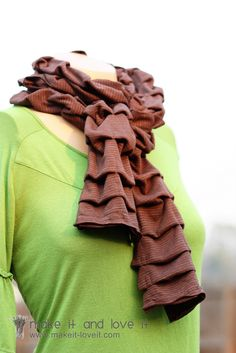 DIY: pleated knit scarf. It would be really fun to do this with several old t shirts that are tones of the same color for a color gradient effect. The seams where the knit scraps would be joined could be hidden at the back of the folds. Have to try this when I get out my sewing machine.