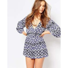 ASOS Tribal Plunge Wrap Beach Playsuit (600.930 IDR) ❤ liked on Polyvore featuring jumpsuits, rompers, tribal print, asos, print romper, plunge romper, patterned romper and tribal romper