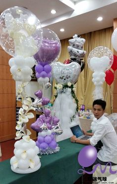 Various examples of wedding balloon columns and centerpieces.