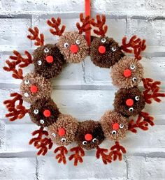 Handmade Christmas reindeer pom pom wreath This beautiful, fun handmade wreath features 10 individual Pom Pom reindeer heads on an 8 inch, yarn wrapped wreath. Complete with hanging ribbon. Made from acrylic yarn, so vegan friendly too. Christmas Pom Pom Crafts, Spring Crafts, Holiday Crafts, Christmas Diy, Christmas Ornaments, Rustic Christmas, Unique Christmas Decorations, Christmas Trees, Homemade Christmas Wreaths