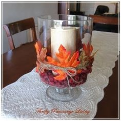 DIY fall decoration, hurricane vase, pillar candle, twine and leaves faux berries or acorns as filler