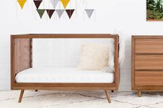 A sleek sleeping space for baby with Ubabub Mid Century Style, Mid Century Design, Traditional Nursery Furniture, Junior Bed, Cots, Kid Beds, Wow Products, One Design, Baby Sleep