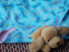 Your baby girl will love this all in one critter blanket. It come with a stuff animal attached to a blanket. When you buy it, it also come with a story too.