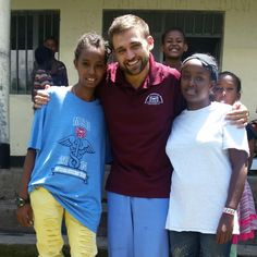 Missouri State University student Bob Sobule helps perform well child checks on children at New Hope Orphanage in Ethiopia after his first year in the physician assistant program.