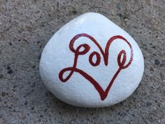 Love. Hand painted rock by Caroline. Borrowed design. The Kindness Rocks Project