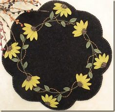 """""""Black Eyed Susans"""" candle mat by Cath's Pennies, available at Wool Felt Central - Wool Felt Patterns"""