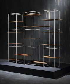 Ron Gilad has added a shelving system and oval table to his TT furniture collection, featuring surfaces that appear to hover unsupported in a metal frame. Cabinet Furniture, Metal Furniture, Furniture Design, Brutalist Furniture, Furniture Ideas, Outdoor Furniture, Design Industrial, Industrial Style, Display Shelves