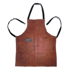 Keep the grill master clean and safe with this durable leather grill apron from Outset. This grilling accessory features a durable brown-suede exterior with a flame-retardant lining while protecting clothes from splatters and hot grease. Kitchen Sink Accessories, Grill Accessories, Smoking Accessories, Leather Accessories, Leather Apron, Suede Leather, Grill Apron, Fire Grill, Kitchen Aprons