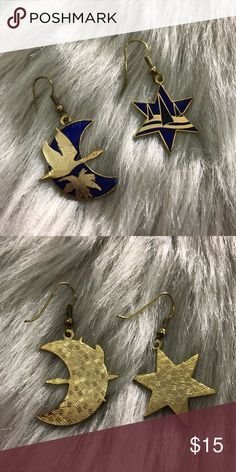 Bird & Sailboats Earrings Bird & Sailboats Earrings Royal blue & gold Earrings are about a 2 in drop from hook Good condition-Graphics of bird & sailboats have faded a bit , hooks aged  Costume jewelry  All earrings come with clear brand new plastic backings & gift box Jewelry Earrings