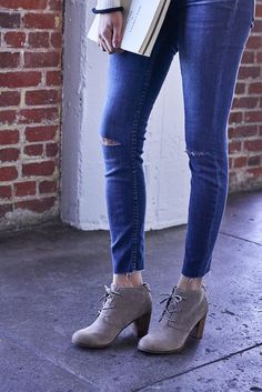 Sophisticated and stylish, the TOMS Lunata Lace-up Bootie in smooth suede with laces and a stacked wooden heal.