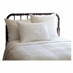 """This cotton quilt brings a charming touch to your guest bedroom with a textural laurel leaf-inspired motif.   Product: Twin quiltConstruction Material: 100% CottonColor: WhiteFeatures: Stitched with a hand-guided embroidery machineDimensions: 70"""" x 90"""" Note: Pillows pictured are not included Cleaning and Care: Machine wash cold and line dry"""