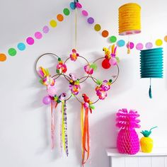 G O  T E A M  G O! A Rio-tastic carnival inspired Olympic wall hanging using @talkingtablesparty flower Leis and parrot ornaments and rings made from embroidery hoops sprayed gold - did you know you can just buy the hoop innards from @minervacrafts? and come on - who doesn't need a neon pineapple in their life? Congratulations @teamgb #rio2016 #flashesofdelight #craftastic #parrot #pineapple #partyinspo #olympicrings