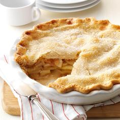"Apple Pie Recipe -I remember coming home sullen one day because we'd lost a softball game. Grandma, in her wisdom, suggested, ""Maybe a slice of my homemade apple pie will make you feel better."" One bite Apple Pie Recipes, Apple Desserts, Köstliche Desserts, Baking Recipes, Delicious Desserts, Dessert Recipes, Taste Of Home Apple Pie Recipe, Apple Pie Recipe Easy, Baking Pies"