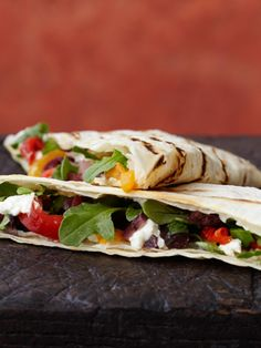 Grilled Flour Tortillas With Goat Cheese, Peruvian Olives, and Roasted Red and Yellow Peppers