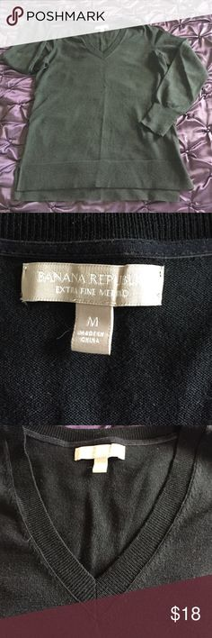 Banana Republic Light Sweater Banana Republic light weight V Neck Sweater. The pictures show it as a very light color but it is actually a true black. This Sweater has been worn one time, no signs of wear, no stains, no pilings, and no fraying. Banana Republic Sweaters V-Necks
