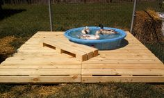 "Solution for us! ""Duck deck!  This one was made from pallets and cost only $5.  A deck is a nice way to prevent mud city around the pool/pond."""