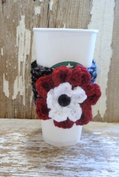 Licorice Twist with Crimson flower crocheted Coffee Sleeve