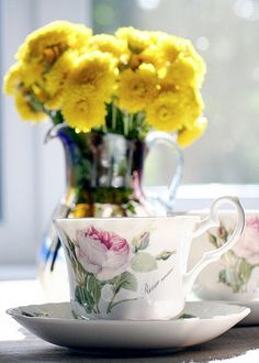 Pretty floral tea cup n yellow flowers