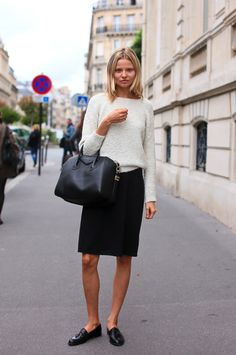 LE FASHION BLOG STREET STYLE FASHION WEEK MODEL OFF DUTY Magdalena Frackowiak BLACK AND WHITE LOOKS FUZZY TEXTURED WHITE SWEATER BLACK KNEE LENGTH SKIRT FLAT LOAFERS TASSELS GIVENCHY ANTIGONA BAG VIA ALTAMIRA BLOG