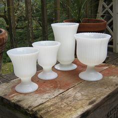 Set of Four Ribbed White Milk Glass Vases by EO Brody. $34.00, via Etsy.