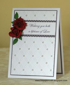 card - perfect plum, gumball green other - dotted scallop ribbon border punch, Big Shot non SU - white linen cardstock, purchased paper roses, rose petal punch and embossing punch, Tied Together embossing folder, glue gun, pearls, computer and printer