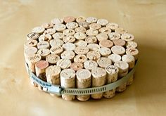 wine cork trivet--easy  i think i will paint the hoop to make it look a little nicer