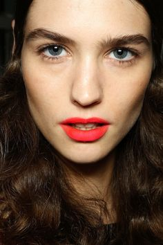 Matte bright red-orange lips