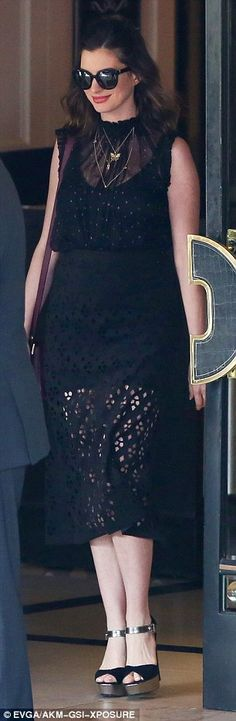 High fashion: Anne's dress consisted of a solid layer of fabric that fell to her thighs and a longer outer layer that was sheer on the top and featured mostly transparent cutouts on the bottom