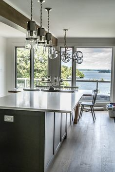 This week's cottage feature (including a kitchen and 2 bathrooms!) is more of the latter, with stylistic choices that are sophisticated but streamlined, contemporary decorative elements, and hardware and appliances to enable a dinner of delicacies.⠀  Take special note of the beverage bar, stocked with coffee accessories above a built-in wine fridge. You'll also note a couple different lighting choices that bring a sense of modernity, contrasted by shiplap walls and wooden beams...