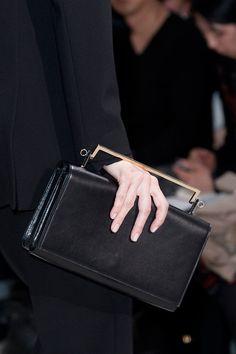 A sleek black clutch. Runway bags Milan Fashion Week Fall 2014 #MFW
