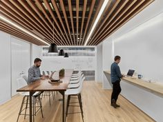 HBO Workspace - Seattle - Ceiling/lights, wood elements, stand up option, collaborative work space