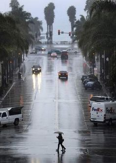 California Street on a rainy day. The ocean at the end of the street is obscured by clouds.