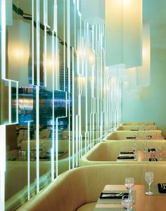 Restaurant design backlit mirrored walls make this stunning design come to life. This glow goes perfect with the mint walls