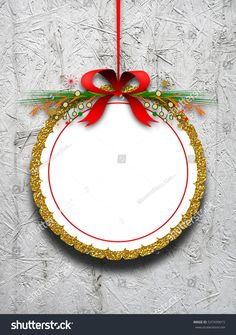 #Blank #round #decorated #ornament #frame hanged by #red #Christmas #ribbon against #gray #wooden #background