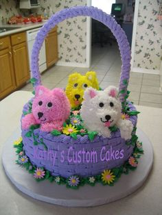 Puppies in a Basket - This idea is from a Wilton book. The little girl requested puppies instead of kittens. Puppies are made from mini-ball pan cakes. All buttercream with royal flowers and royal basket handle.